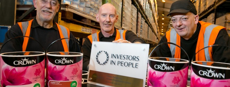 (L-R) Crown Paints staff members Colin Bolton, John Carroll and Ian Brindle with the IIP Gold award